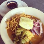 Khao Soi - northern Thai yellow curry noodles with chicken, chilli oil and pickles