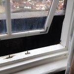 Bottom right of window, bracket holding window together