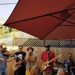 Invincible Grins band playing on the patio at AZ Stronghold!