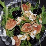 When Fresh Figs are in Season, we love to feature a Fig Salad.  This is a seasonal item.