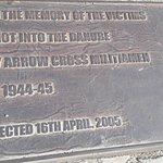 Inlaid plaque explaining the memorial.