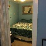 """Second bedroom room of """"suite"""" -- no windows."""