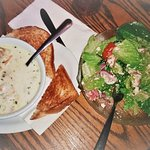 Seafood chowder with a greek-style salad
