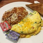 Vegie omelette and hashbrowns with toast.