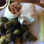 This is a turkey bacon wrap with cranberry mayo and roasted brussel sprouts with mushrooms!!!