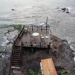 "For an added cost, you can eat your dinner out on ""the Rock"" with the ocean around you"