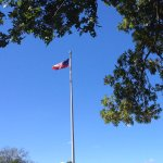The flag flying over the Memorial Gravesite