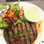 Scotch fillet steak with garlic sauce