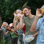 Happy people enjoying a fruit stop