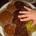 Large plate of delicious food (adult hand shows the size)!