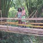 Crossing over bamboo bridge to the falls.