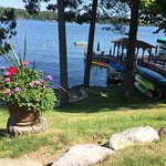Evening lakeside campfire, kayaks, swimming, glass of wine dockside.