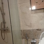 Small bathroom - partial view of shower & toilet bowl
