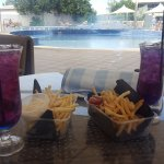 Fruit tingles and chips from the pool cafe.