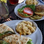 Fried green tomato BLT and Crab cake sandwich with mac and cheese and housemade pickles