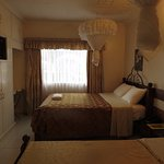 A double room with a queen and a double bed. Can accommodate up to three adults.