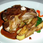 Costata di Vitello: Grilled 16oz Veal chop, fingerling potatoes, broccoli Rabe, truffle, veal po