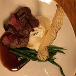 petite steak with mashed potatoes and green beans