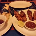 satays and fried spring rolls