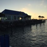 """Sunset on the water's edge looking past the Lazy Lizard """"Boat House Bar"""""""
