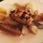 Salmon with traditional Greek sauce and Greek potatoes
