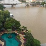 View of the pool and the Chao Phraya river and pool from our 12th floor room