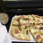 "Mushroom, Italian sausage and ""cream"" cheese pizza."