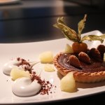 Warm chocolate tart with coconut purée