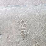 Masons' markings on a stone column