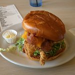 Fried chicken sandwich with bacon and cheese.