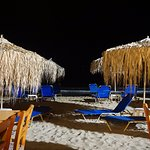 The beach by Mistrali is lit up at night