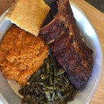 Small serving of ribs with corn bread, mashed sweet potatoes and green beans