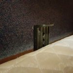 Bedframe protruding from boxspring