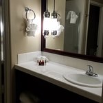 pretty lights and mirror, single sink - separate shower from tub