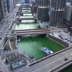 The Chicago River dyed green after a St. Patricks Day parade.
