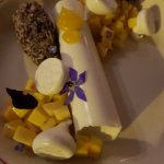 Coconut panna cotta with mango salsa and black sticky rice