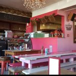 The restaurant is cute, pink and has indoor and outdoor seaing