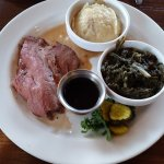 Roast beef with mashed potatoes and greens.