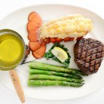Steak and lobster with steamed asparagus.