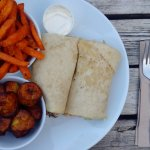 Jerk chicken roti, plantain wedges and sweet potato chips