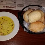 Fresh, hot rolls with olive oil and spices to dip them into.