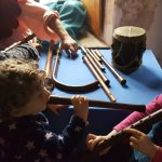 Our girls trying out some of the mediaeval instruments