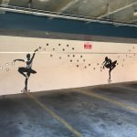 Whimsical ballerinas in the parking area