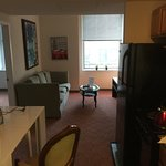 View if the little kitchen and living room as you enter the apartment