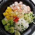Organic Salmon, Mango, white rice,Cucumber, Avocado, Coconut, Macadamia nuts w/Coconut Lime Dres