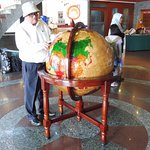 Hotel guest study the World Globe for his next travel