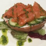 Fresh bagel topped with Scottish smoked salmon, dill Crealine cheese and pickled cucumber