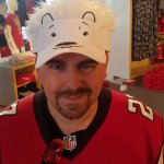 The polar bear visor makes my husband look like Guy Fieri