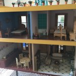Miniature furniture inside a doll house (this is the back side)
