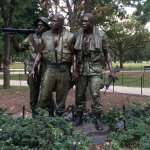 Viet Nam soldiers at memorial entrance.